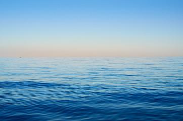 Fototapeta Sea waves on a background of blue sky