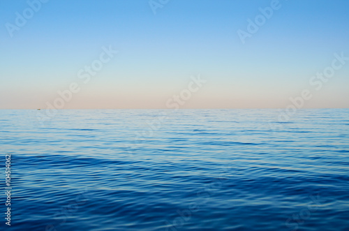 Fotobehang Zee / Oceaan Sea waves on a background of blue sky