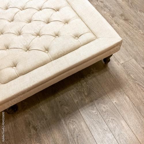 Fotografia  Fancy ottoman on wooden floor