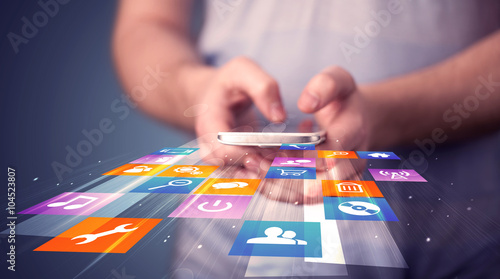 Fotografía Man holding smart phone with colorful application icons