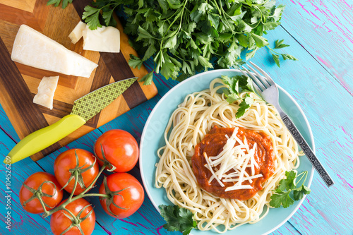 Fotografie, Obraz  Above view of spaghetti plate and tomatoes