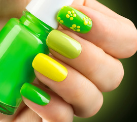 Panel Szklany Do Spa Spring green manicure. Bottle of nail polish
