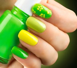 Fototapeta Do Spa Spring green manicure. Bottle of nail polish