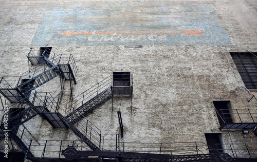 Photo Stands Stairs Fire escape on outside wall historic and vintage