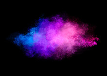 Colorful Dust Particle Explosion Isolated On Black Background