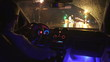 2 in 1 video! The man drive a car in the rainy city. Inside view. Evening-night time, real time capture. Wide angle