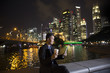 Chinese businessman outdoors at night using his digital tablet d