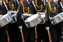 Military Band Drummers Marching At The Parade
