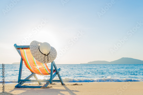 Fotografija Deck chair at the tropical sandy beach