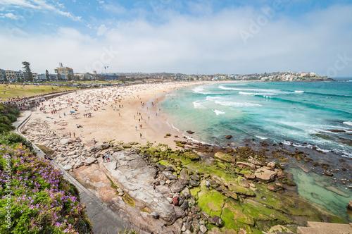Bondi Beach, Sydney, Australia - OCT 25, 2014: Tourists and swimmers relaxing on the beach in summer at Bondi Beach