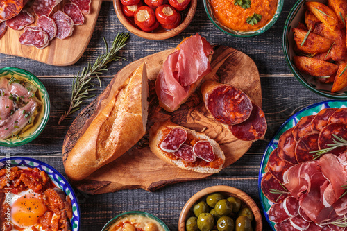 Foto  Typical spanish tapas concept, rustic style,  top view.