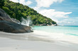 A view on tropical white sandy beach with rocks, forest, sky and waves hitting the rocks. Similan islands, Thailand, Phuket.