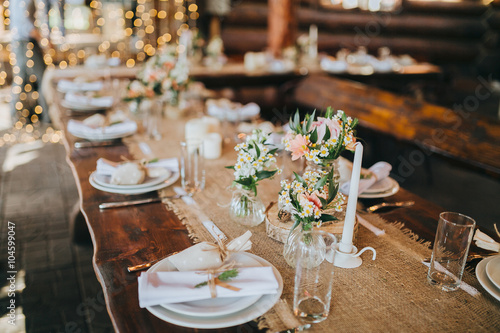 Fotografie, Obraz  decorations made of wood and wildflowers served on the festive table