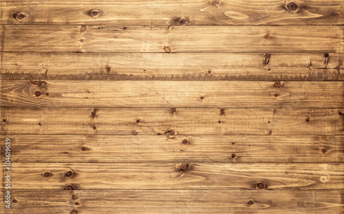 Tuinposter Hout Light brown wood texture background viewed from above. The wooden planks are stacked horizontally and have a worn look. This surface would be great as design element for a wall, floor, table etc…