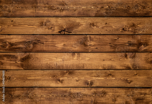 Foto op Plexiglas Hout Medium brown wood texture background viewed from above. The wooden planks are stacked horizontally and have a worn look. This surface would be great as design element for a wall, floor, table etc…