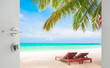 opened white door to beautiful beach with beach chairs under coconut tree