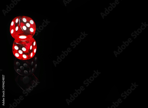 Photo  Two red casino dices with  reflection . black background