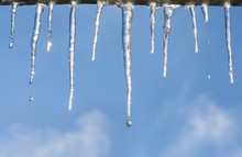 Icicles With Drops On Blue Sky