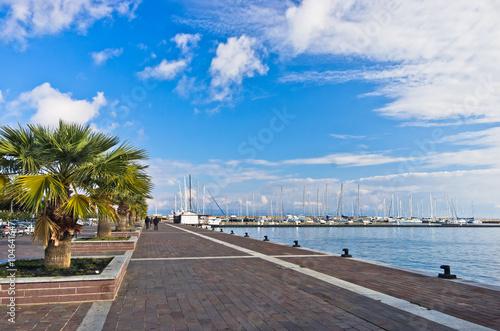 Foto auf Gartenposter Stadt am Wasser Waterfront and marina at Carloforte harbor, San Pietro island, Sardinia, Italy
