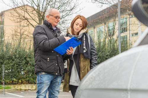 Driving instructor shows results examined to his student