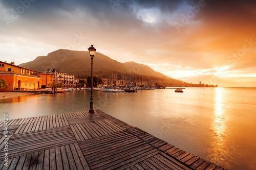 Obraz na płótnie romantic sunrise on the bay on Lake Garda