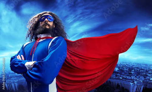 Fotografía Portrait of a superheroe posing over the urban landscape