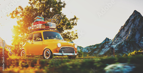 Fotografie, Obraz  Cute little retro car goes by wonderful countryside road at sunset
