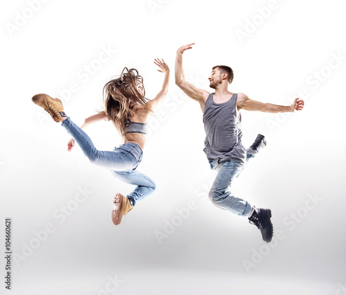 Obraz na plátne Dancing couple over the white background