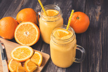 Orange Fruit Smoothie In The Glass Jars