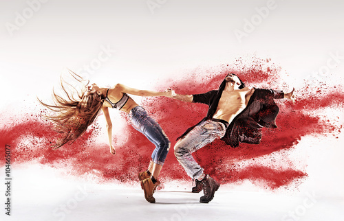 Talented young dancers sprinkling red dust