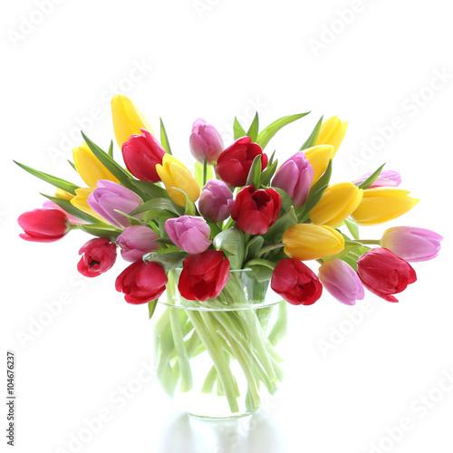 Tulips in a glas vase - 104676237