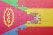 canvas print picture - puzzle with the national flag of spain and eritrea