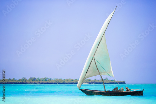 Spoed Fotobehang Zanzibar Old wooden dhow in the Indian Ocean near Zanzibar