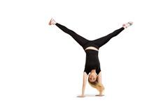 Caucasian Woman Doing Cartwhee...