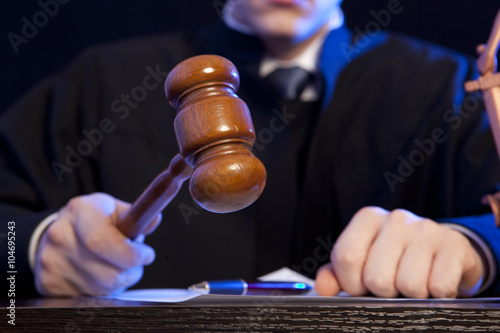 Fotografering  Male judge in a courtroom