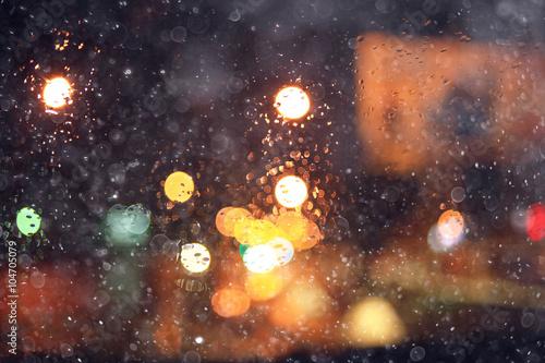 Fototapeta blurred background night city lights flashing drops obraz na płótnie