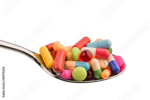 Fotografia  Viele Tabletten auf Löffel