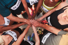 Team With Hands Together After Competition