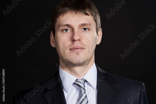 Fototapeta Oleg, man in white shirt and gray suit