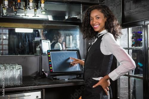 Happy barmaid preparing a bill Canvas Print
