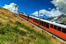 Electric Tourist Train And Famous Misty Matterhorn Peak,Switzerland,Europe