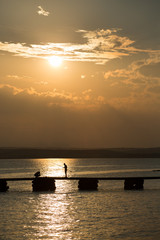 fisherman on sunset at sea