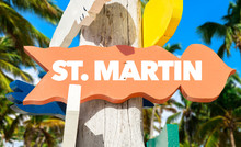 St Martin Direction Sign With Palm Trees