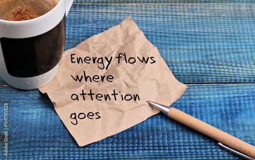 Fotografía  Inspiration motivation quotation Energy flows where attention goes and cup of co