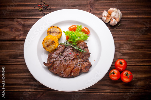 Fototapety, obrazy: Beef steak with vegetables and seasoning on a wooden background