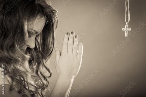 Fototapeta Woman praying to god jesus with cross necklace. obraz na płótnie