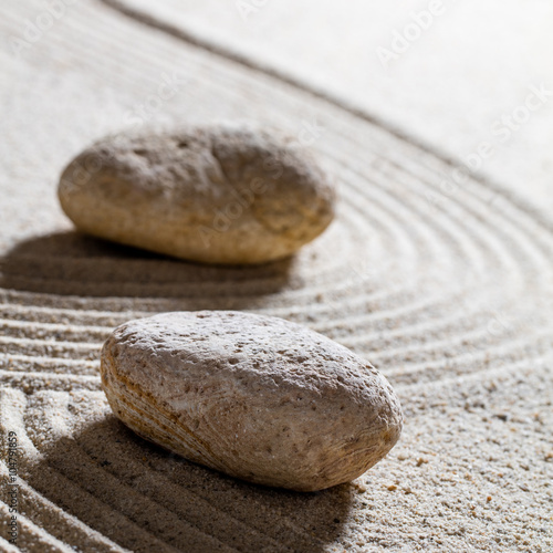 Acrylic Prints Stones in Sand zen sand still-life - stones set on sinuous lines for concept of progression or change with inner peace, closeup