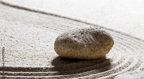 Acrylic Prints Stones in Sand zen sand still-life - single stone for the concept of harmony or wellness with care and smoothness, closeup