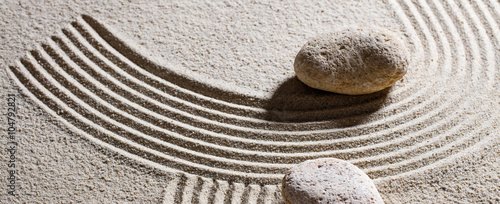 Foto op Plexiglas Stenen in het Zand zen sand still-life - two pebbles for concept of dead end or imagination with peace and elevation