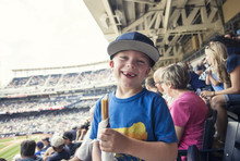 Young Boy Enjoying A Day Watching A Professional Baseball Game